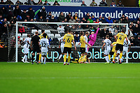 Freddie Woodman of Swansea City makes a save during the Sky Bet Championship match between Swansea City and Millwall at the Liberty Stadium in Swansea, Wales, UK. Saturday 23rd November 2019