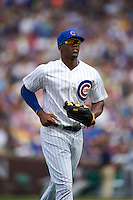 Chicago Cubs outfielder Jorge Soler (68) jogs to the dugout in between innings during a game against the Milwaukee Brewers on August 13, 2015 at Wrigley Field in Chicago, Illinois.  Chicago defeated Milwaukee 9-2.  (Mike Janes/Four Seam Images)