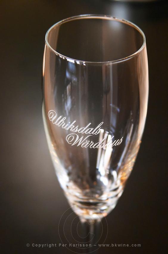 A champagne glass with the name of the restaurant: Ulriksdals Wärdshus against a black background Ulriksdal Ulriksdals Wärdshus Värdshus Wardshus Vardshus Restaurant, Stockholm, Sweden, Sverige, Europe