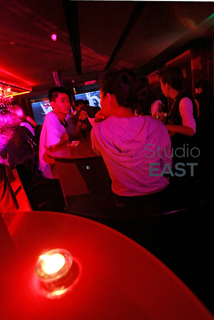 Customers enjoy a drink in Bar Rouge in Shanghai, China, on May 9, 2008. Photo by Lucas Schifres/Pictobank