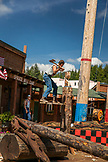 ALASKA, Ketchikan, one man competes to see how quickly he can chop down a stump during the Great Alaskan Lumberjack Show