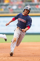 Mookie Betts (12) of the Pawtucket Red Sox hustles towards third base against the Charlotte Knights at BB&T Ballpark on August 8, 2014 in Charlotte, North Carolina.  The Red Sox defeated the Knights  11-8.  (Brian Westerholt/Four Seam Images)