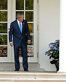 Washington, D.C. - June 11, 2007 -- United States President George W. Bush looks at his pet dog, Miss Beazley, as he walks on the Colonnade to the Oval Office after he and first lady Laura Bush returned to the White House after an eight day visit to Europe in Washington, D.C. on Monday, June 11, 2007.  <br /> Credit: Ron Sachs - Pool