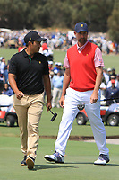 C.T. Pan (International) and Webb Simpson (USA) on the 16th green during the First Round - Four Ball of the Presidents Cup 2019, Royal Melbourne Golf Club, Melbourne, Victoria, Australia. 12/12/2019.<br /> Picture Thos Caffrey / Golffile.ie<br /> <br /> All photo usage must carry mandatory copyright credit (© Golffile | Thos Caffrey)