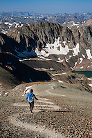 Female hiker descending from Handies peak (14053 ft), San Juan mountains, Colorado, USA
