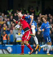 Gary Cahill of Chelsea clears Troy Deeney of Watford during the Premier League match between Chelsea and Watford at Stamford Bridge, London, England on 21 October 2017. Photo by Andy Rowland.