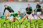 Billy Maguire Legion gets away from Michael Dorgan and Tomas O'Sé Nemo Rangers during the AIB Munster club SFC clash in Pairc Uí Rinn on Sunday