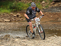 NWA Democrat-Gazette/ANDY SHUPE<br /> Michael Green of West Helena rides across Lee Creek Saturday, Sept. 19, 2015, during the Northwest Arkansas Mountain Bike Championships at Devil's Den State park.