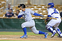 Peoria Javelinas infielder Cheslor Cuthbert (9), of the Kansas City Royals organization, at bat in front of catcher Chris O'Brien during an Arizona Fall League game against the Glendale Desert Dogs on October 14, 2013 at Camelback Ranch Stadium in Glendale, Arizona.  Glendale defeated Peoria 5-1.  (Mike Janes/Four Seam Images)