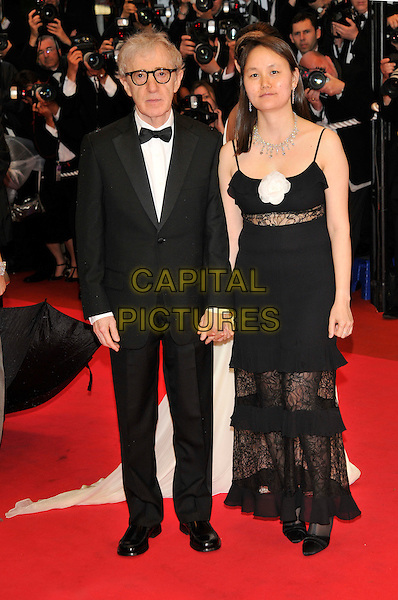 "WOODY ALLEN & SOON-YI PREVIN.""""Vicky Cristina Barcelona"" premiere.61st Cannes International  Film Festival, France.17th May 2008 .full length dinner suit dj tuxedo red carpet photographers wife black dress.CAP/PL.© Phil Loftus/Capital Pictures"