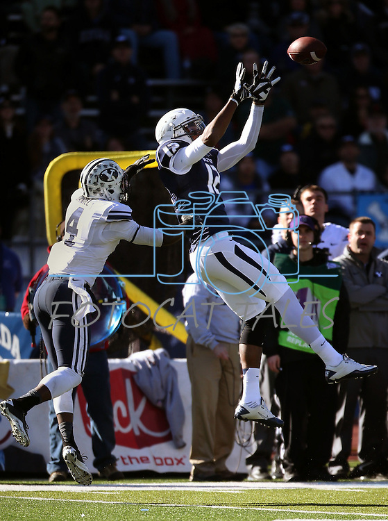Nevada's Hasaan Henderson (12) goes up for catch against BYU defender Robertson Daniel (4) during the first half of an NCAA college football game in Reno, Nev., on Saturday, Nov. 30, 2013. (AP Photo/Cathleen Allison)