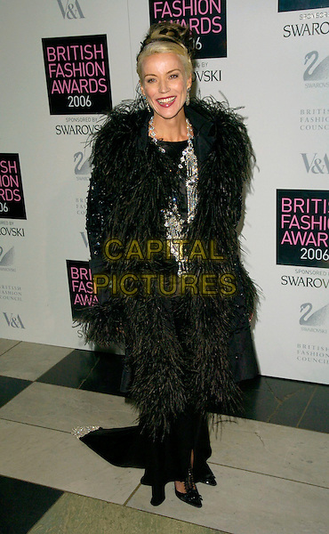 DAPHNE GUINNESS.British Fashion Awards 2006, Victoria & Albert Museum, Lodon, UK..November 2nd, 2006.Ref: CAN.V&A full length black coat feathers trim.www.capitalpictures.com.sales@capitalpictures.com.©Can Nguyen/Capital Pictures