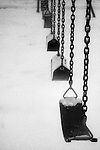 Child's swings covered in snow