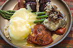 Edwardian Breakfast of eggs, black sausage, bacon, potatoes asparagus, tomatoes