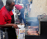 4 D'S Catering's Sylvester Saffold grills brats at the 23rd annual Madison Juneteenth Day celebration on Sat., 6/16/12, at Penn Park in Madison, Wisconsin