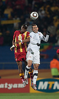 Ghana's Andre Ayew fights for a header with the USA's Herculez Gomez in the second round of the 2010 FIFA World Cup match between USA and Ghana in Rustenberg, South Africa on Saturday, June 26, 2010.  Ghana won 2-1.