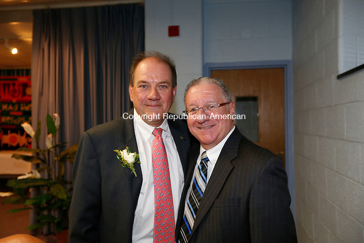 Litchfield, CT- 30 September 2015-093015CM23- Social moments--  From left, ​​ ​honoree William Harding of Winsted with Owen Quinn, executive director at the United Way of Northwest Connecticut, are photographed during The 2015 Wisdom Award celebration at the Wisdom House Retreat and Conference Center in Litchfield on Wednesday.     Christopher Massa Republican-American