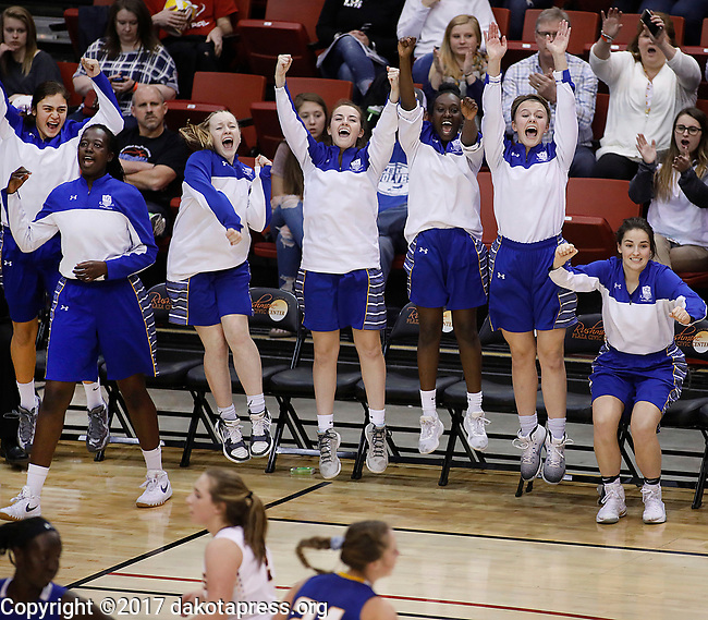 RAPID CITY, SD - MARCH 18, 2017 -- The Sioux Falls O'Gorman bench celebrates a basket late in regulation against Harrisburg during the 2017 South Dakota State Class AA Girls Basketball Championship game Saturday at Barnett Arena in Rapid City, S.D.  (Photo by Dick Carlson/Inertia)