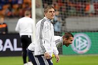 Sebastian Jung und Lukas Podolski (D)