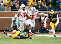 Ohio State Buckeyes running back Ezekiel Elliott (15) runs over Michigan Wolverines linebacker Joe Bolden (35) during the first quarter of the NCAA football game in Ann Arbor on Nov. 28, 2015. (Adam Cairns / The Columbus Dispatch)