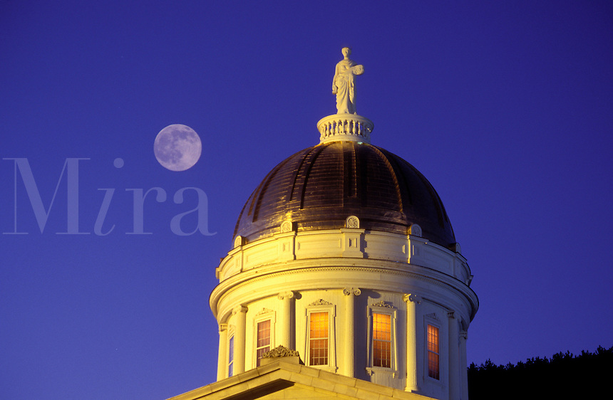 AJ1065, Vermont, Montpelier, The golden dome of the State House under the full moon is illuminated at night in Montpelier.