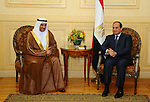 A handout picture provided by the Office of the Egyptian Presidency shows Egyptian President, Abdel Fattah al-Sisi, meets with  Sheikh Hamad bin Mohammed Al Sharqi, governor the emirate of Fujairah, upon his arrival to attend the 26th Arab Summit in Sharm al-Sheikh, 27 March 2015. The Arab summit is set to run 28 and 29 March with the current unrest in Yemen topping the agenda as Saudi Arabia at the head of a coalition of Muslim countries carries out airstrikes against Houthis which have so far claimed some 40 civilian lives with many more injured, and is said to be mulling the option of sending ground forces in to reinstate what they are calling the legitimate government headed by Abdo Rabbo Mansour Had. Photo by Egyptian Presidency