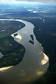 Araguaia River, Amazon, Brazil. Aerial view; river, tributary with islets and sediment deposition on bends.
