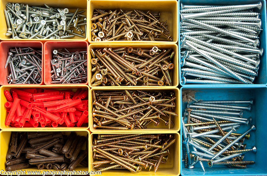 Colourful carpentry box of metal screws viewed from above