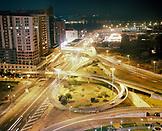 CHINA, Macau, Asia, illuminated bridge by buildings at night