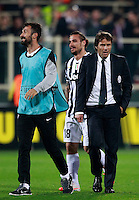 Calcio, ritorno degli ottavi di finale di Europa League: Fiorentina vs Juventus. Firenze, stadio Artemio Franchi, 20 marzo 2014. <br /> From left, Juventus forwards Mirko Vucinic, Pablo Daniel Osvaldo and Antonio Conte celebrate at the end of the Europa League round of 16 second leg football match between Fiorentina and Juventus at Florence's Artemio Franchi stadium, 20 March 2014. Juventus won 1-0 to advance to the quarter-finals.<br /> UPDATE IMAGES PRESS/Isabella Bonotto