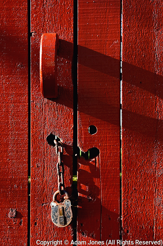 Red door with lock and chain, Kentucky Horse Park, Lexington, Kentucky