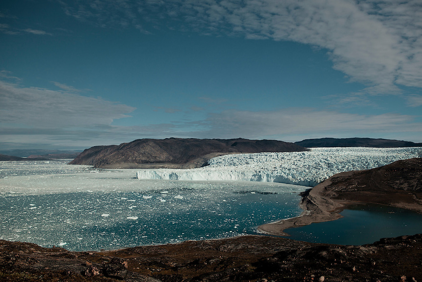 The Eqi glacier and icebergs, West Greenland, August 2011. The extent of the glacier ten years prior is marked by the grey moraine ridge at right. Photo: Ed Giles.