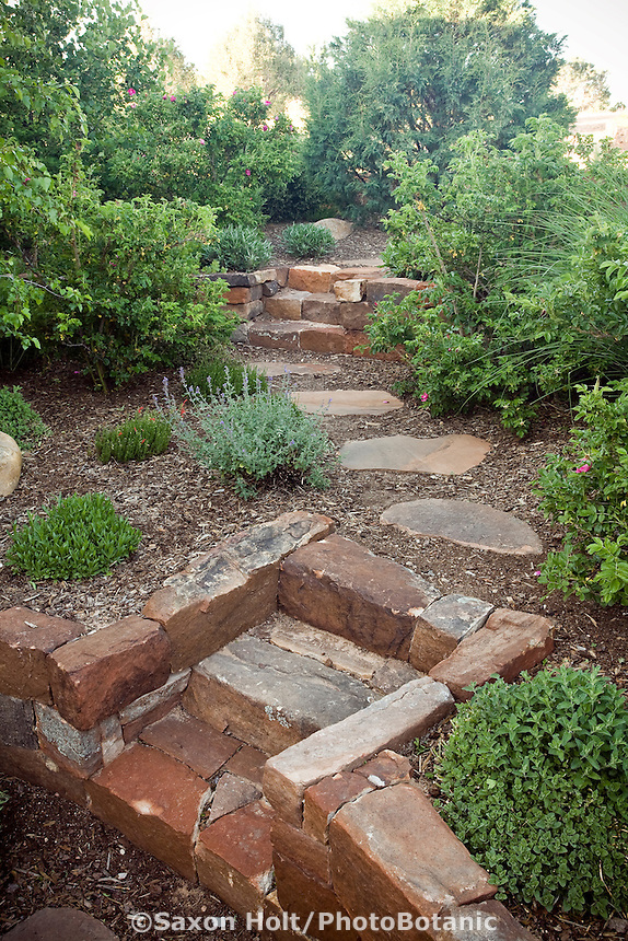 Stone steps and pathway through New Mexico xeriscape, drought tolerant garden