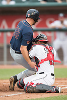 Lansing Lugnuts catcher Andres Sotillo (13) blocks the plate as Bowling Green Hot Rods baserunner Bobby Melley (30) crashes into him during the Midwest League baseball game on June 29, 2017 at Cooley Law School Stadium in Lansing, Michigan. Bowling Green defeated Lansing 11-9 in 10 innings. (Andrew Woolley/Four Seam Images)