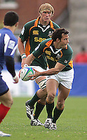 South African centre Francois Hougaard is moves play wide during the Division A U19 World Championship clash at Ravenhill.