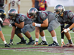 Torrance, CA 09/19/15 - Joshua Molina (Torrance #74) and unidentified Torrance player(s) in action during the Peninsula Panthers - Torrance Tartars Varsity football game at Torrance High School
