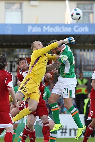 31.05.2016, Turners Cross Stadium, Cork, Ireland. International football friendly between republic of ireland and Belarus.  Daryl Murphy of Republic of Ireland clears under presure from Siarhei Chernik of Belarus