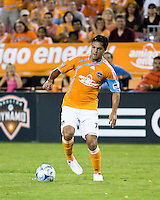 Houston Dynamo forward Luis Angel Landin (7) dribbles the ball.  Houston Dynamo tied Seattle Sounders 1-1 on August 23, 2009 at Robertson Stadium in Houston, TX.