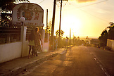 MAURITIUS, driving through a small rural town at sunset