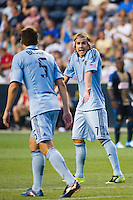 Chance Myers (7) of Sporting Kansas City talks with Matt Besler (5). Sporting Kansas City defeated the Philadelphia Union 2-0 during the semifinals of the 2012 Lamar Hunt US Open Cup at PPL Park in Chester, PA, on July 11, 2012.