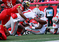 Ohio State Buckeyes quarterback Dwayne Haskins Jr. (7) scores a touchdown in overtime of their game at Maryland Stadium in College Park, MD on November 17, 2018. [ Brooke LaValley / Dispatch ]