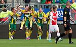 Nederland, Den Haag, 23 september  2012.Seizoen 2012/2013.Eredivisie.Ado Den Haag-Ajax.Tom Beugelsdijk (2e van links) juicht na het scoren van de 1-0.