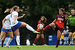 04 October 2015: Virginia Tech's Anissa Dadkhah (3) beats Duke's Ashton Miller (4) to a loose ball. The Duke University Blue Devils hosted the Virginia Tech Hokies at Koskinen Stadium in Durham, North Carolina in a 2015 NCAA Division I Women's Soccer match. Virginia Tech won the game 4-2.