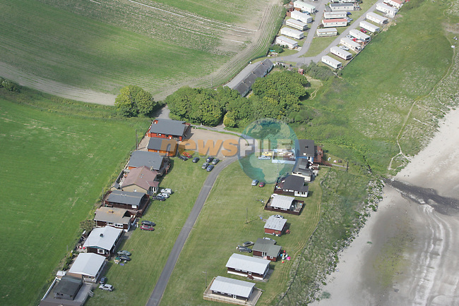 Aerial view of the Chalets and Caravans, Clogher Cove, Clogherhead.  04/06/06...Photo NEWSFILE/Fran Caffrey.(Photo credit should read Fran Caffrey/NEWSFILE)....This Picture has been sent you under the condtions enclosed by:.Newsfile Ltd..The Studio,.Millmount Abbey,.Drogheda,.Co Meath..Ireland..Tel: +353(0)41-9871240.Fax: +353(0)41-9871260.GSM: +353(0)86-2500958.email: pictures@newsfile.ie.www.newsfile.ie.FTP: 193.120.102.198...This picture is from Fran Caffrey@newsfile.ie