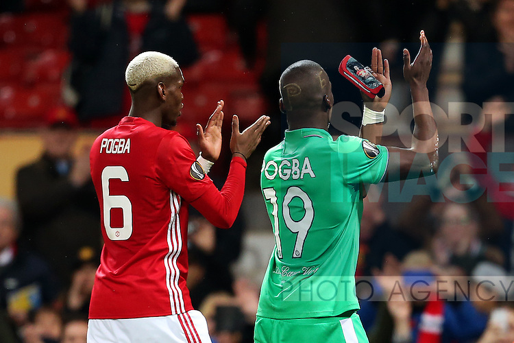 Paul Pogba of Manchester United and brother Florentin Pogba of Saint Etienne at full time  during the UEFA Europa League Round of 32 1st leg match at Old Trafford Stadium, Manchester. Picture date: February 16th, 2017. Pic credit should read: Matt McNulty/Sportimage