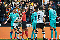25th January 2020; Mestalla, Valencia, Spain; La Liga Football,Valencia versus Barcelona; Referee  Gil Manzano marks penalty in favor to Valencia CF and shows a yellow card to Gerard Piqué of FCB on minute 10'