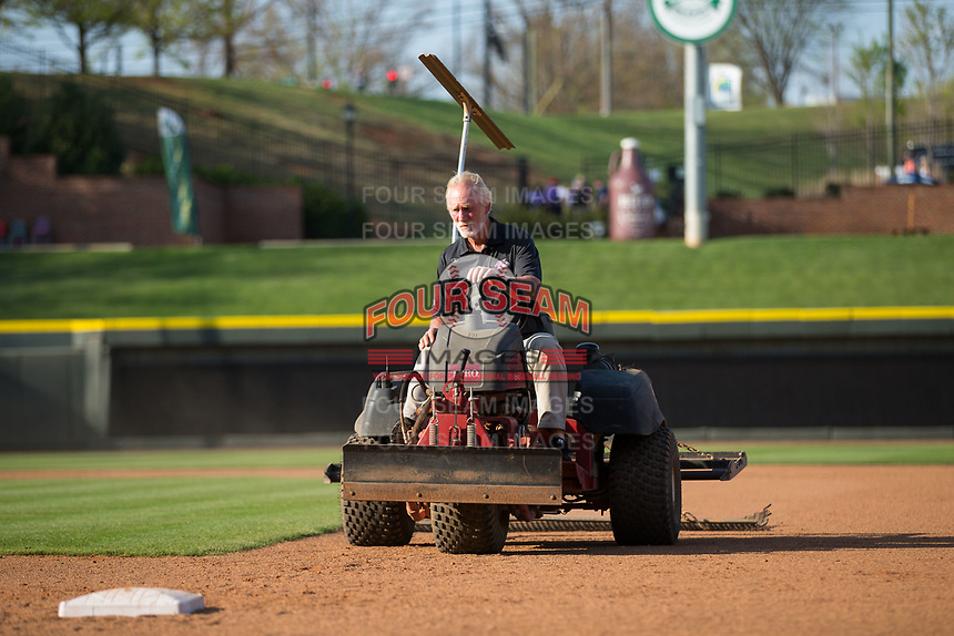 Winston-Salem Dash head groundskeeper Paul Johnson gets the field ready for the Carolina League game against the Buies Creek Astros at BB&T Ballpark on April 13, 2017 in Winston-Salem, North Carolina.  The Dash defeated the Astros 7-1.  (Brian Westerholt/Four Seam Images)