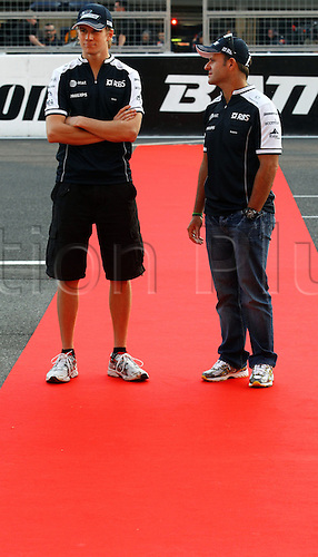 07.10.2010 Brazilian driver Rubens Barrichello (R)of Williams F1 and his German team-mate Nico Huelkenberg (L)arrive to sign autographs at Suzuka Circuit in Suzuka, Japan. The 2010 Formula 1 Japanese Grand Prix is held on 10 October.