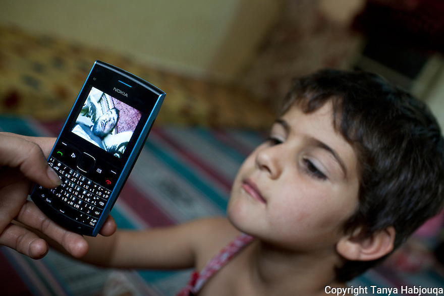 Aysha's daughter watches a video of a dying Syrian fighter in the southern Syrian city of Deraa, where the family comes from. Her aunt Yasmine explains that the purpose of showing the children such videos is not to scare them, but to teach them why their fathers must leave -- to fight injustice.