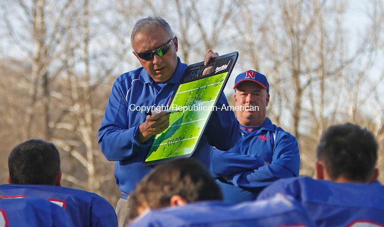 Woodbury, CT111613MK05 Nonnewaug's coach John Oko instructs his players at the half time break during Berkshire League football action against Gilbert / Northwestern Saturday afternoon at Nonnewaug High School in Woodbury.  Gilbert / NorthWest defeated Nonnewaug 27-7. Michael Kabelka / Republican-American